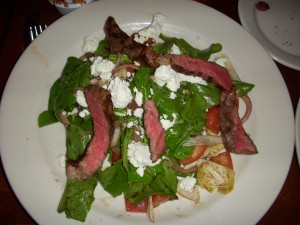 Huge steak, arugula, endive, tomato, onion, and goat cheese salad