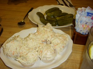 Creamy cole slaw and crunchy sour pickles