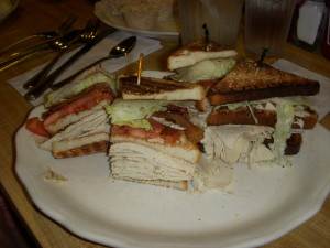 Towering high triple decker turkey club