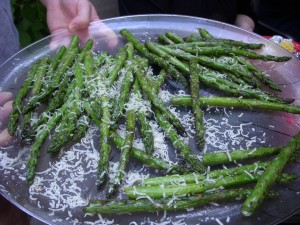 Grilled asparagus covered in grated parmesan cheese
