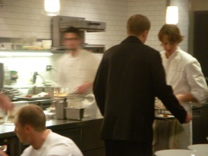 Chef Achatz inspecting a plate before it goes out