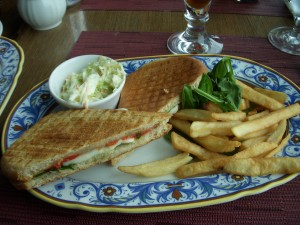 Mozzarella, roasted pepper, and basil panini with french fries and cole slaw
