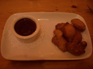 Frittelle with chocolate-basil sauce.