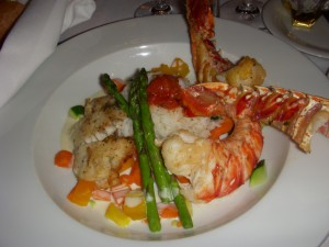 Lobster and grouper over basmati rice with asparagus and diced vegetables