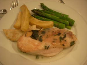 Chicken in garlic sauce, potato wedges, asparagus