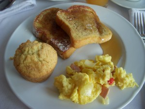 French toast, scrambled eggs with ham, muffin
