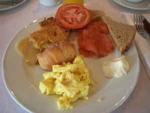 Scrambled eggs, croissant, potato pancake w/applesauce, smoked salmon with tomato, brown bread, and cream cheese