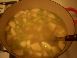Boiling the potatoes and sauteed leeks in chicken stock