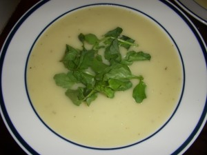 Creamy soup topped with crunchy watercress