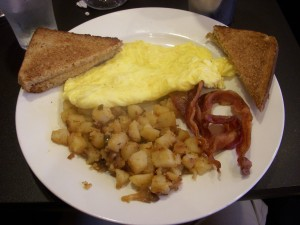 Bacon, home fries, scrambled eggs, whole wheat toast