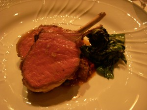 Rack of lamb with puttanesca sauce and sautéed basil