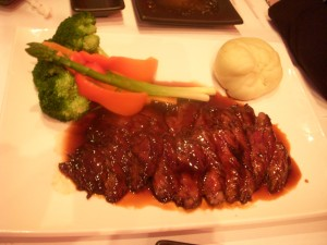 Grilled skirt steak with miso-teriyaki sauce, vegetables, and wasabi mashed potatoes