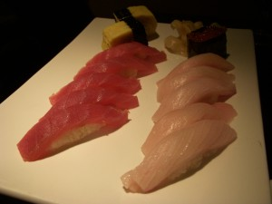 Tuna, yellowtail, tamago, and ikura sushi