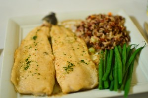 Trout ala meuniere with lemon parsley brown butter wild rice medley and green beans