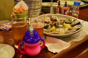 Happy hour at Luke - 50 cent oysters, half priced beer, and milk in a sippy cup