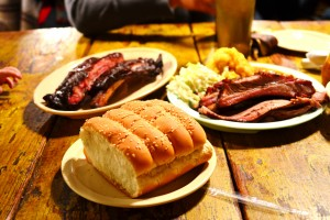 Table of food (and you can see J's little hand reaching out to snag a rib!)