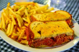 Corned beef sandwich with swiss, and french fries