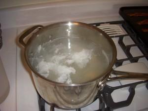 Eggs poaching in vinegar and water