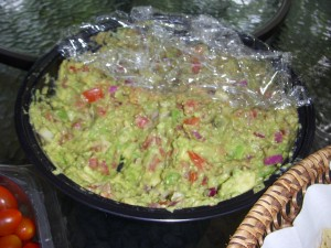 Fresh guacamole with avocado, tomato, red onion, lemon juice, and seasonings
