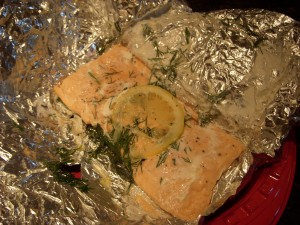 salmon grilled in a foil packet with dill and lemon