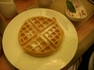 Waffle with strawberry cream on the side