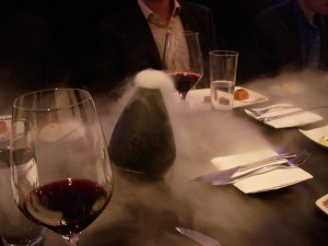 In preparation for the next course, they poured water into a vase that contained dry ice, which released steam that smelled like rosemary and grill smoke
