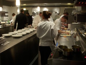 Everyone hard at work plating in the kitchen