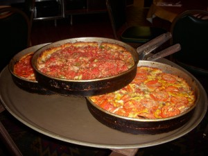 Deep dish Chicago pizza served hot out of the pan
