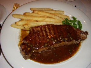 Grilled sirloin steak with peppercorn sauce and french fries