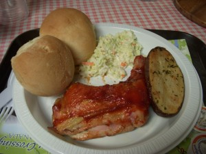 BBQ Chicken, roasted potato, cole slaw, and dinner rolls