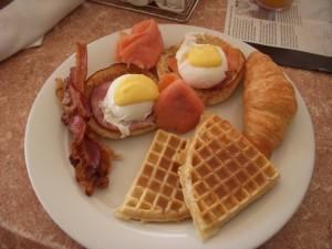 Crispy bacon, smoked salmon eggs benedict, croissant, waffles
