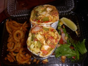 Mixed grill naan sandwich and seasoned curly fries