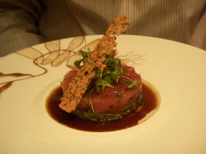 Tuna tartare on top of fennel salad with ginger ponzu sauce