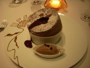 Chocolate souffle with chocolate ganache and mocha ice cream