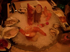 Assorted oysters, prawns, and Alaskan king crab legs