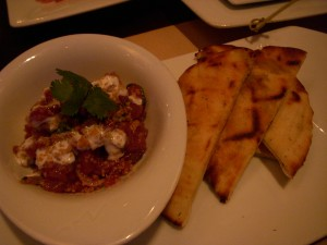 Tuna tartare with pine nuts and pomegranate, served with pita bread