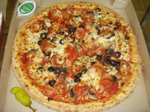 Large pizza with pepperoni, mushrooms, and black olives