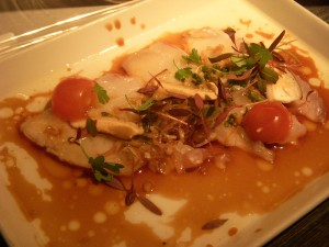 Fluke crudo seared with hot oil