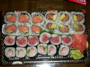 Spicy tuna roll, salmon avocado roll, tuna roll, and yellowtail scallion roll