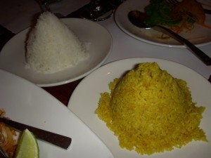 A cone of curry rice and a cone of white rice