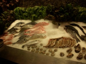 The fish are displayed on ice and you can pick the one you want