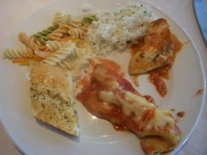 Garlic bread, pasta salad, coconut rice, chicken in tomato sauce, vegetarian canneloni