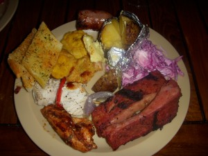 BBQ ribs, BBQ chicken, fish kebabs, garlic bread, fried green plantains, sausage, baked potato, cole slaw