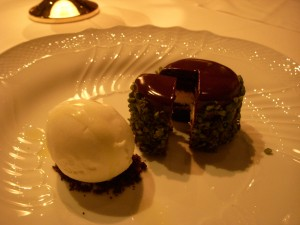 Chocolate ricotta tortino with pistachios and extra virgin olive oil gelato