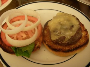 Thick, juicy burgers on brioche with lettuce, tomato, and onions
