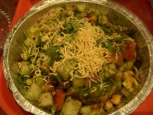 Disappointing alu chaat with bland, almost raw potatoes