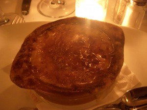 French onion soup covered in a thick layer of gruyere