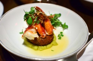 Butter poached lobster with crispy pork and split pea emulsion