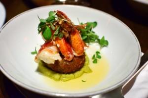 Butter poached lobster with crispy pork and split pea emulsion