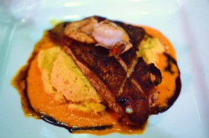 Blackened snapper and grits with bay shrimp, tomato harvati grits, red pepper goat cheese coulis, and balsamic reduction